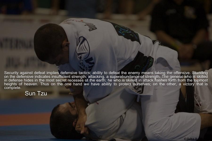 Two men grappling in jiu jitsu competition