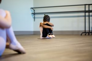 Child scared to try something new in dance class